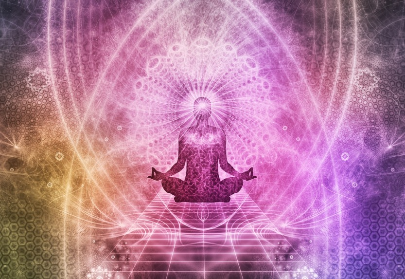 person meditating in a psychedelic vision